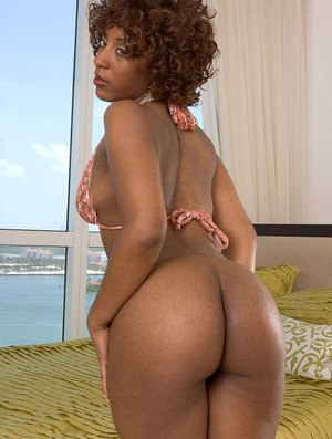 Hot black chick Jazzy Jade touts her big butt before masturbating with a dildo