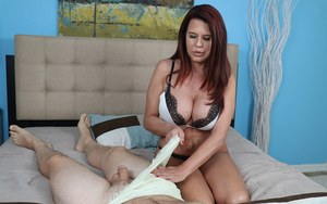 Middle-aged woman Grace Evangeline set her hooters loose while jerking a cock