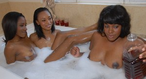 3 black chicks have a drink before getting naked and into a bubble bath