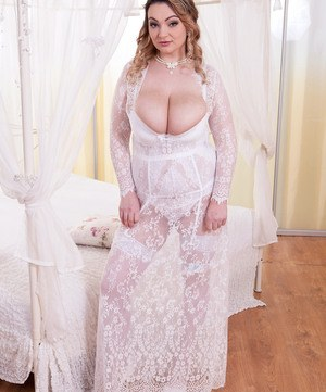 Solo model Micky Bells strips off her bridal attire before masturbating
