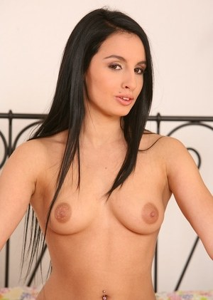 Teen girl with jet black hair fingers her pink pussy on her daybed