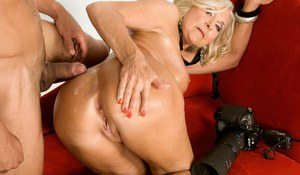 Hot older lady with nice tits gets fucked in the ass by a much younger man