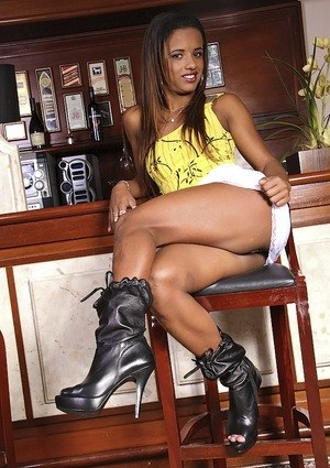 Latina female Cris Lira strips to her black boots inside a local diner