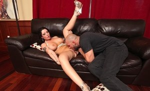 Busty brunette female Melina Mason gets poked by a big dick on a leather couch