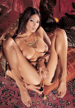 Hot Asian chick Tera Patrick slips a sex toy into her sweet pussy