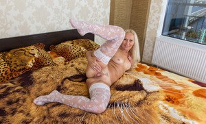 Older lady removes her white lingerie to showcase her twat in white stockings