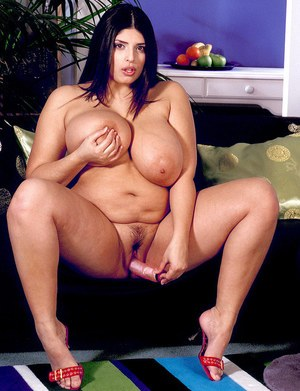 Dark haired BBW Kerry Marie undresses before toying her vagina