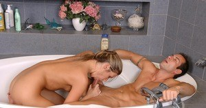 Hot female Cherry Jul and her hung guy friend do a 69 in the bathtub