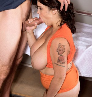 Brunette fatty Trinity Michaels gives the prison guard a blowjob