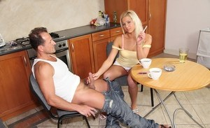 Blonde amateur Candy Love gives a blowjob while having a coffee and a smoke