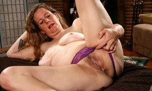 Older woman Magnolia releases her hairy vagina from lace underwear