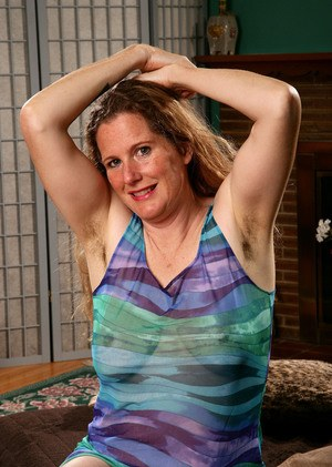 Mature woman with hairy underarms goes about revealing her beaver