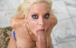 Nude blonde chick Mae Hellfire gets mouth fucked by a huge cock
