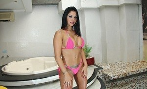 Brunette Latina Gina Jolie takes off her pink bikini to model in the nude