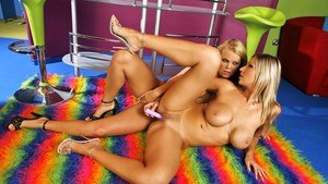 Hot blonde lesbians Trisha and Carol brings sex toys to their sex session