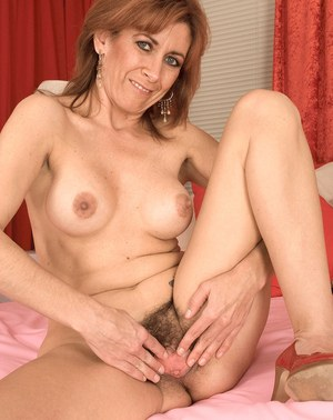 Middle aged broad Mikela Kennedy pleases herself with a huge sex toy