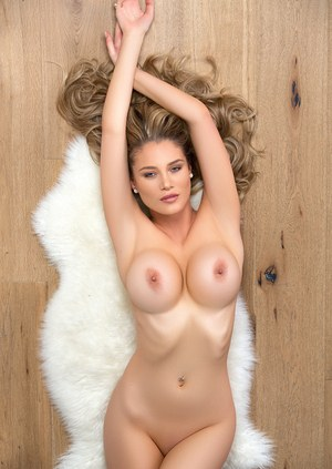 Hot blonde chick Anna Opsal tales off her sexy lingerie for a centerfold shoot