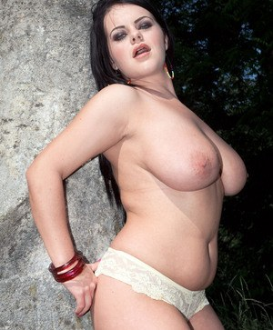 Brunette plumper Mandy Pearl tosses her smoke aside to strip naked in a field