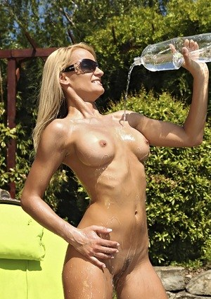 Blonde chick Erica Fontes pours water over naked body after bikini removal