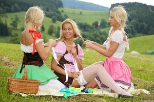 Young blonde girls have a lesbian threesome in the Swiss Alps