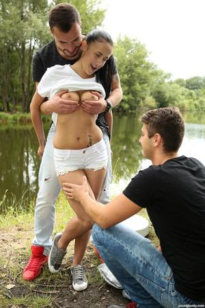 Young brunette girl fuck her guy and his friend on a camping expedition