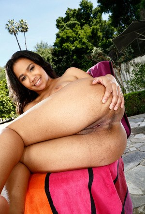 Ebony amateur Loni Legend shows off the pink off her twat in courtyard