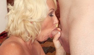 Older blonde lady with nice tits gives a younger man oral sex