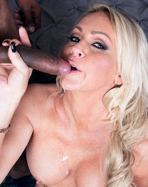 Sexy older lady Brianna Shay spits jizz after blowing a black cock