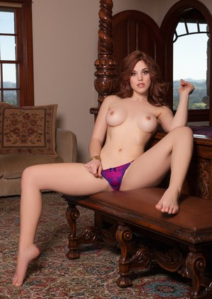 Hot centerfold model Molly Stewart removes her bra and panty set