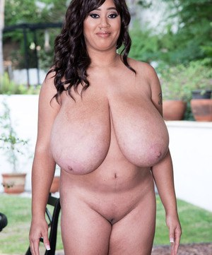 BBW Roxi Red proudly exhibits her monster boobs in the backyard
