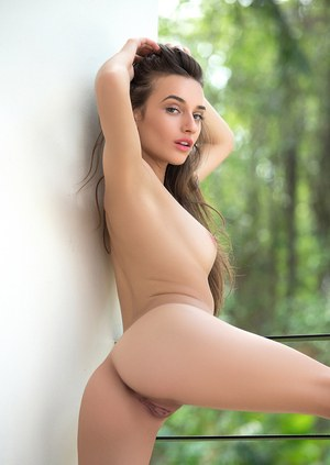 Solo girl Gloria Sol shows off her pleasing face while posing nude for Playboy