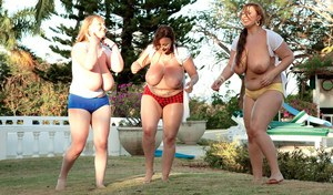 Fat chicks unleash their huge boobs before having a sack race
