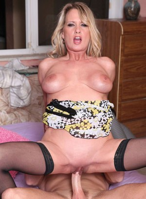 Hot middle-aged broad Bridgette Lee seduces a younger guy in black nylons