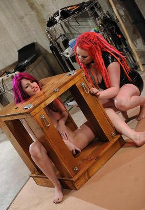 Kinky lesbians experiment with box bondage after bare ass spanking