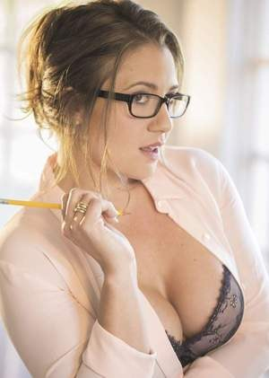 Nerdy solo model Victoria James takes off her clothes for sexy nude poses