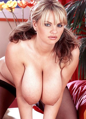 Solo model Kelly Kay shows off her massive tits wearing black nylons