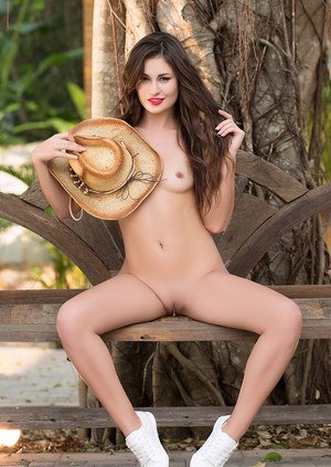 Beautiful solo model Demi Fray takes off her country girl clothes for Playboy
