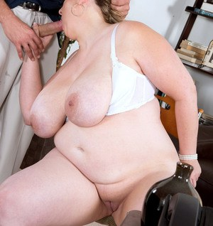 Obese secretary Amiee Roberts gives her boss oral sex in his office