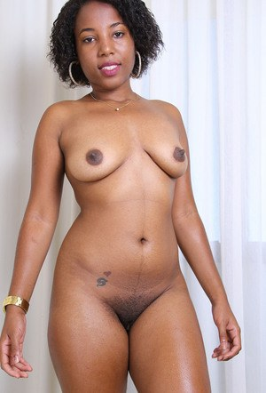 Black amateur folds back her labia lips to display the pink of her pussy