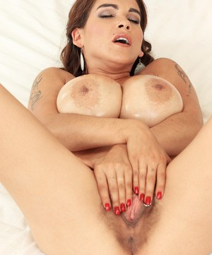 Solo model Mischel Lee unveils her huge tits and all natural pussy