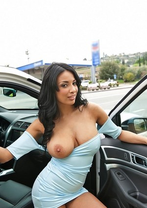 Dark haired solo model Anissa Kate lets her big tits fall out of her dress