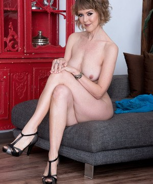 Sexy older woman Jamie Foster takes off her sheer lingerie to pose naked
