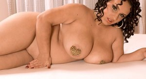 Fat female Anna Carlene flaunts her big ass as she gets naked on her bed