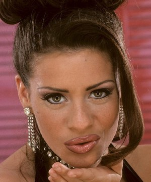 Hot MILF Linsey Dawn McKenzie releases her hooters as she strips to stockings