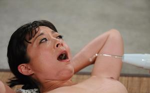 Naked Asian female undergoes painful BDSM training at the hands of her Master