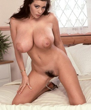 Dark haired female Linsey Dawn McKenzie frees her monster tits from her bra