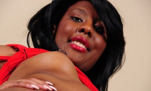 Black amateur takes off her red dress and underwear to display her beaver