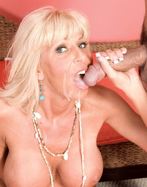 Big boobed older blonde offers up her pussy to a younger man