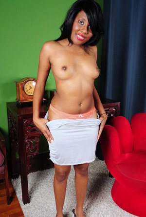 Cute black girl takes off her dress prior to showing her wide open beaver