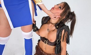 Asian lesbians eat pussy during a threesome attired in cosplay outfits